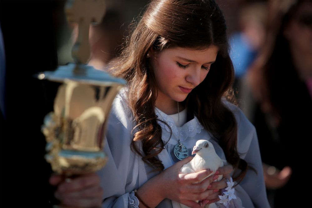 Dove bearer Stella Bilirakis, 15, calms the dove during Epiphany at Spring Bayou in Tarpon Springs, Florida on Sunday, January 6, 2019. The celebration in Tarpon Springs is often called the largest Epiphany celebration in the Western Hemisphere.