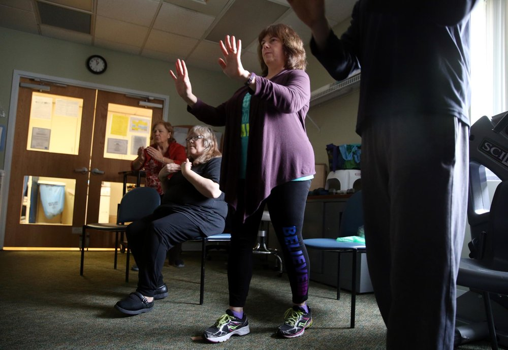 CRAIG F. WALKER/GLOBE STAFF  Jodie Berry took part in a tai chi class at the Functional Restoration Program for Pain Management at the Spaulding Outpatient Center in Medford.