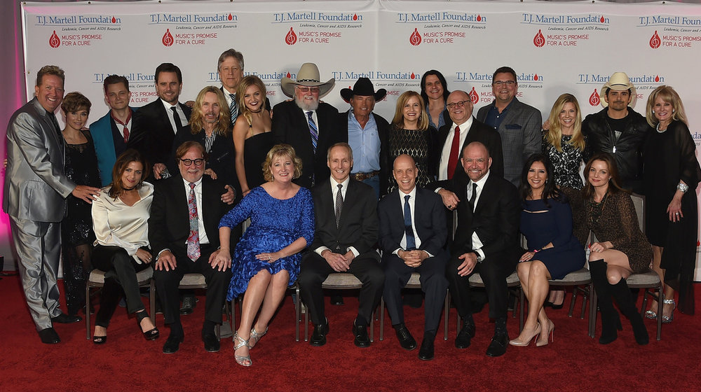 Front row L to R: Co-chair Ali Harnell; honorees Rod Essig, Janet Miller, Dr. Joseph Smith, Scott Hamilton and Louis Messina; Co-chair Danielle Bouharoun and Kimberly Williams Paisley; Back row L to R: Shawn Parr, Clare Bowen, Frankie Ballard, Charles Esten, Tommy Shaw, John Huie, Kelsea Ballerini, Charlie Daniels, George Strait, Nashville Mayor Megan Barry, Will Evankovich, Joel Katz, Storme Warren, Tracie Hamilton, Brad Paisley and the T.J. Martell Foundation's Laura Heatherly attend the 9th Annual Nashville Honors Gala at Omni Hotel on February 27, 2017(Photo by Rick Diamond/Getty Images for T.J. Martell Foundation)