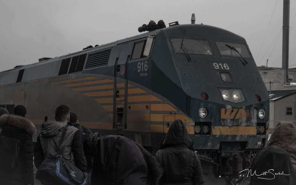 Passengers anxiously waiting to board VIA Rail Train #84 bound for Union Station in Toronto. Shot with a Canon EOS M5 at 1/600, f/6.3 and ISO 200.