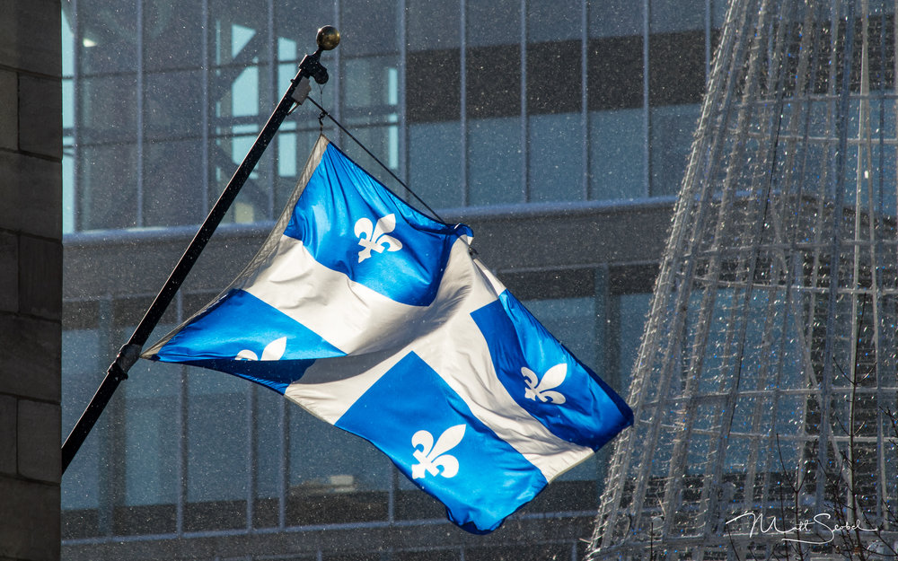 The familiar fleurs-de-lis of Quebec's provincial flag, proudly on display in downtown Quebec City, Canada. Taken with a Canon EOS M5 and a 70-300MM lens at 300MM, 1/400, F/9 and ISO 100.