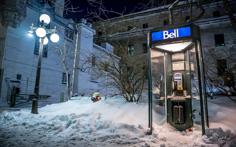 A lonely, still functioning, Bell phone booth in Quebec City, Canada. Shot with a Canon EOS M5 at 15MM, 1/20, F/3.5 and ISO 400.