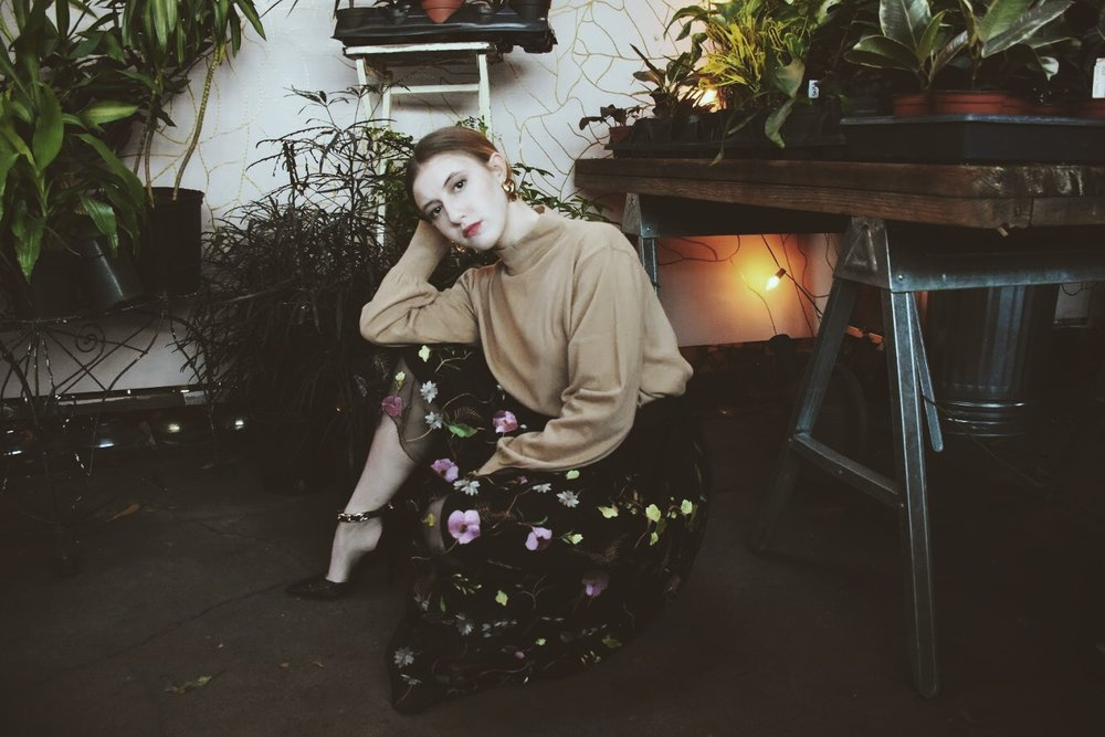 Elise Kaltenreider poses at Flowers and Weeds, a garden shop in St. Louis, MO.