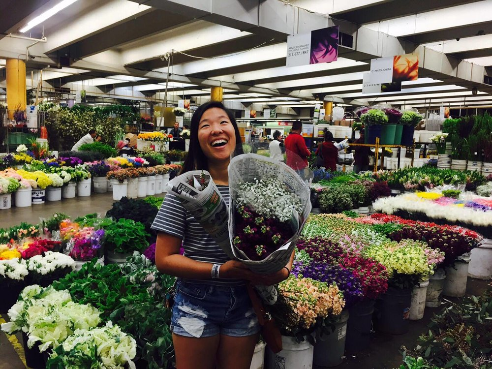 Faline Chiang enjoying being surrounded by flowers.