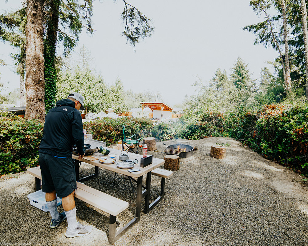 man preparing lunch at a picnic area