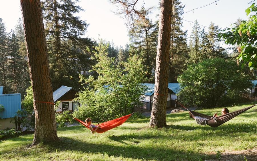 travelers relaxing in kammok hammocks