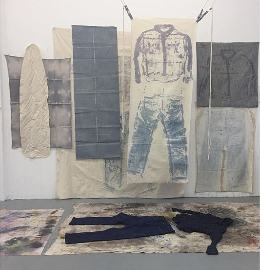 E.M. FULLER    E.M. Fuller is a multidisciplinary artist and founder of  Fuller Rosen Gallery  in Portland, OR. Her work investigates the material associations of fabric, with an acute focus on shifting the viewer's understanding of how fabric functions as a material in everyday life. Currently she is working in performative and activated fabric sculpture and installation with an emphasis in pedestrian choreography, repetition, and gesture. Fuller is a graduate of the Visual Studies Master of Fine Arts program at the Pacific Northwest College of Art in Portland, OR.