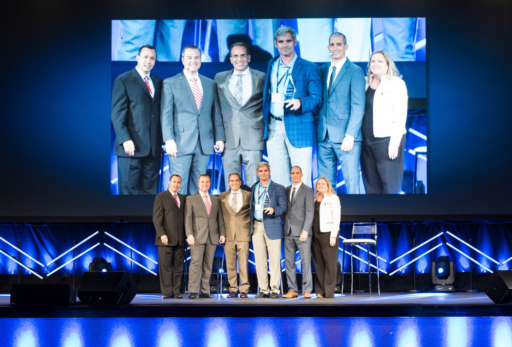 The Elite Ortho team receiving the first  Arthrex Medical Education Award.