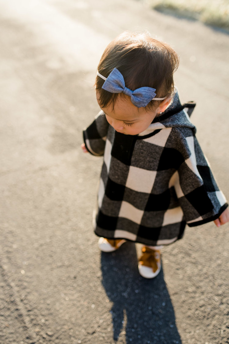 I think you guys loved this poncho almost as much as you loved the chambray birdie bow! And I don't blame you. It's perfect!   Buffalo check poncho:  https://www.zara.com/us/en/kids/baby-girl-%7C-3-months---4-years/sweaters-and-cardigans/check-poncho-c269277p4661373.html   Ecru corduroy trousers:  https://www.zara.com/us/en/kids/baby-girl-%7C-3-months---4-years/leggings-and-trousers/basic-corduroy-trousers-c776501p4685577.html   Leather plimsolls:  https://www.zara.com/us/en/kids/baby-girl-%7C-3-months---4-years/shoes/leather-plimsolls-c269282p4985046.html