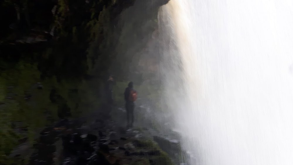 A blurry image behind the waterfall!