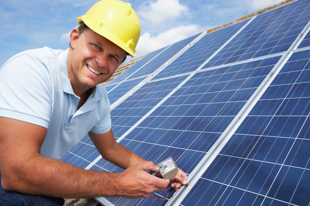 bigstock-Man-installing-solar-panels-25315085 2.jpg