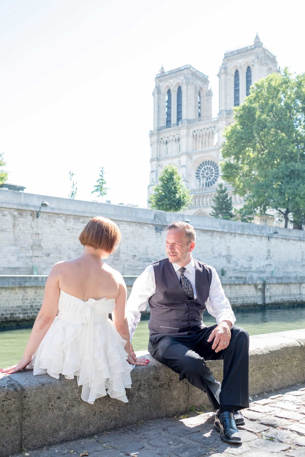 andrea & bill - I had the good fortune to photograph this spellbinding couple from Canada on a warm, sunny Paris day. We explored three areas of the city, starting at the Eiffel Tower, then making our way to the Louvre and finally, Notre Dame. Andrea had a change of outfits and brought along some great props that really lent a special something to the images. It was such a pleasure photographing this wonderful couple!See more images here