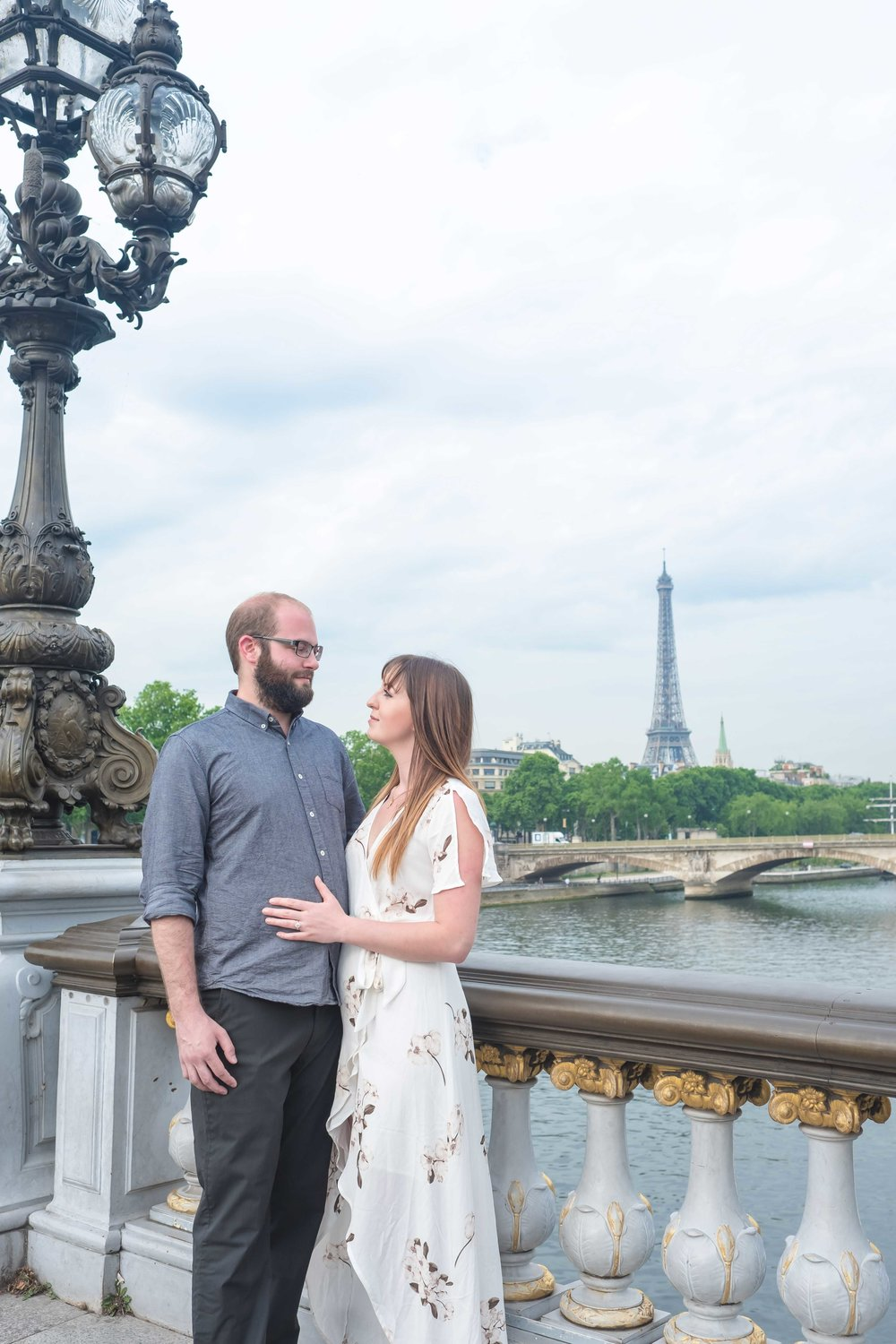 ryan & jenelle - Ryan and Jenelle were celebrating their engagement in Paris, visiting for the first time. This friendly and pretty couple from Canada were a joy to spend the morning with. We started our session on the beautiful bridge of Alexandre and made our way through the green Tuileries Gardens, to the courtyard of the Louvre, visited the royal gardens and ended on the Pont des Arts. It was a really fun and relaxing morning!See more images here