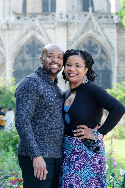 Happy couple at Notre Dame in Paris