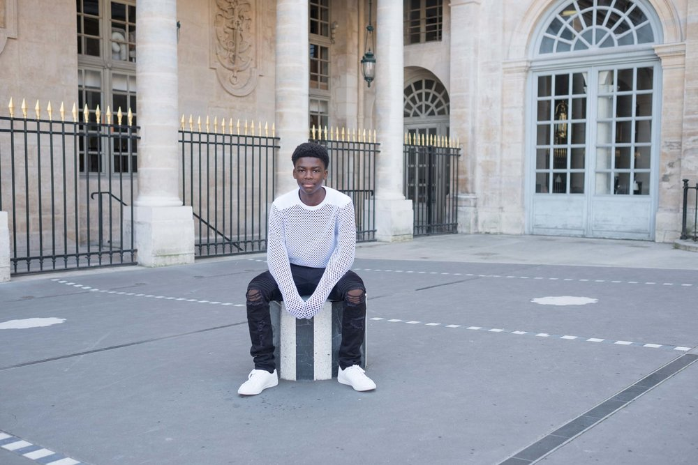 Teenage boy posing for a photo shoot in Paris