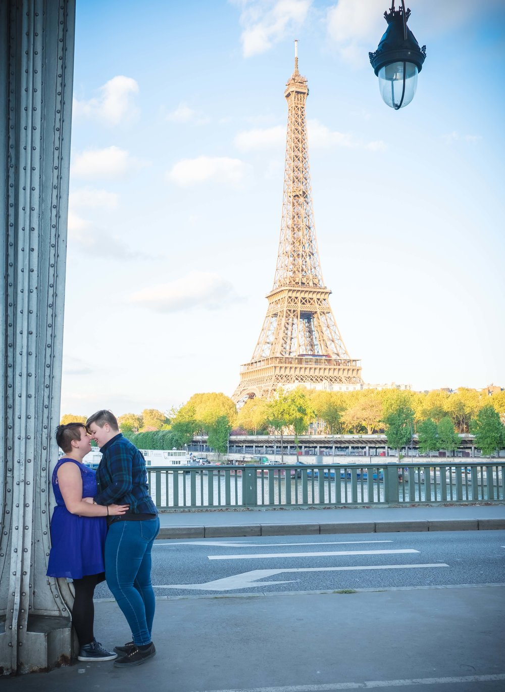 Same sex couple in love after engagement in Paris with view of the Eiffel Tower