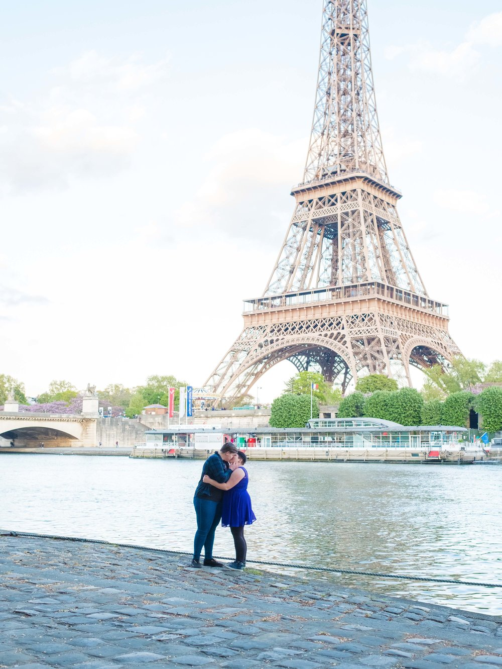 Newly engaged same sex couple in Paris with the Eiffel Tower