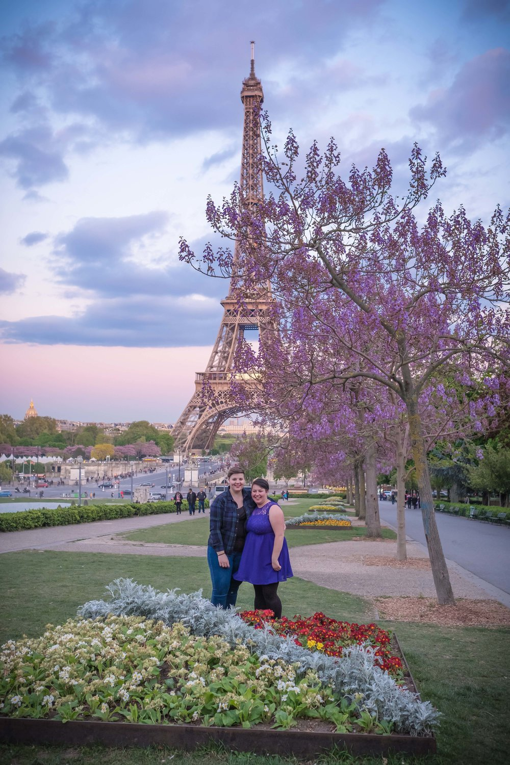 Newly engaged same sex couple in Paris in spring at the Eiffel Tower