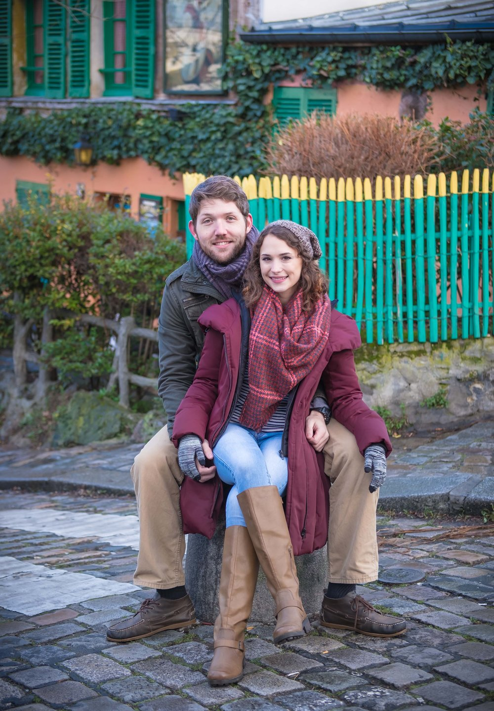Newly engaged couple posing in front of Lapin Agile in Paris