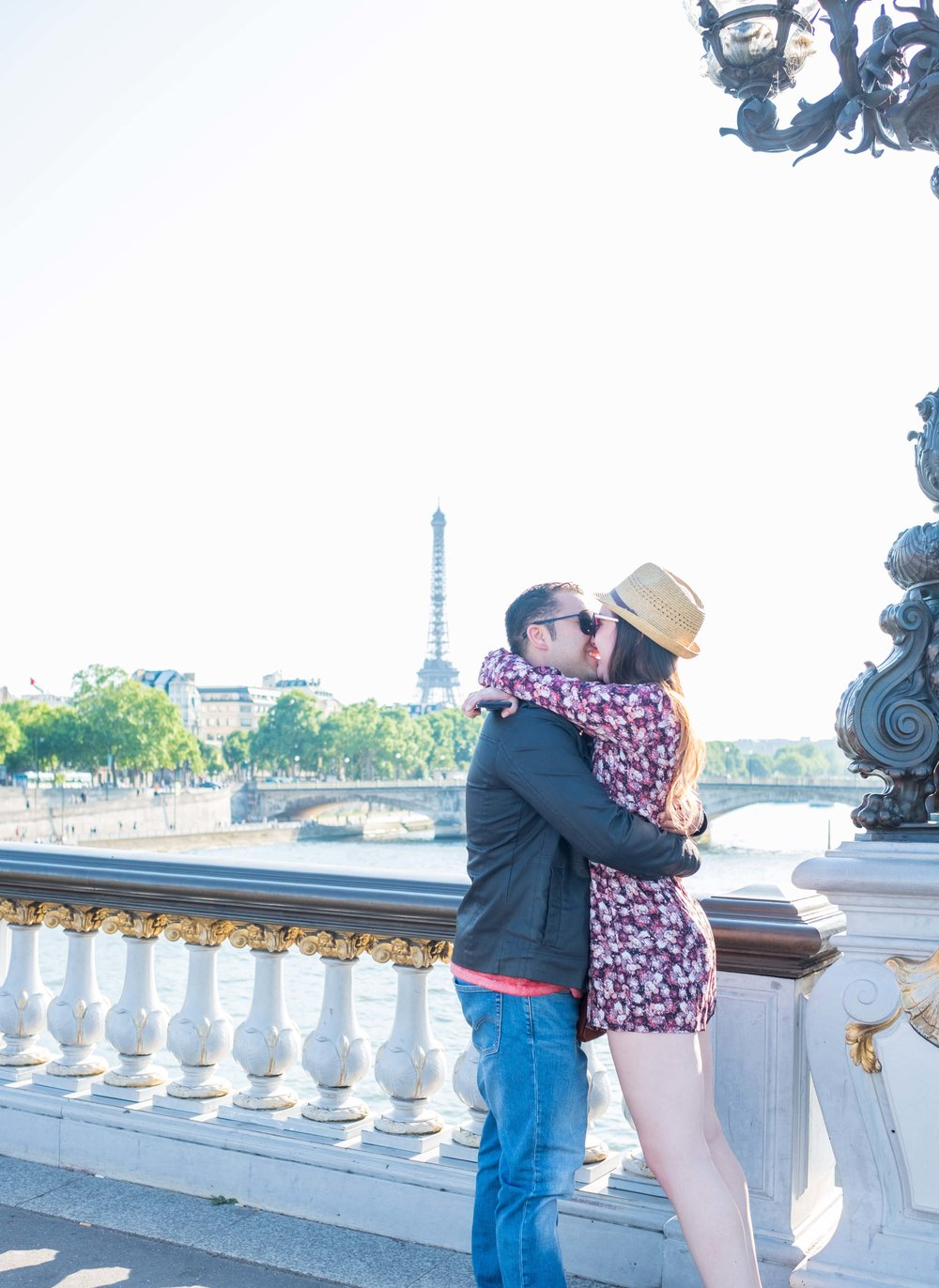 Surprise proposal on Pont Alexandre Bridge with view of Eiffel Tower