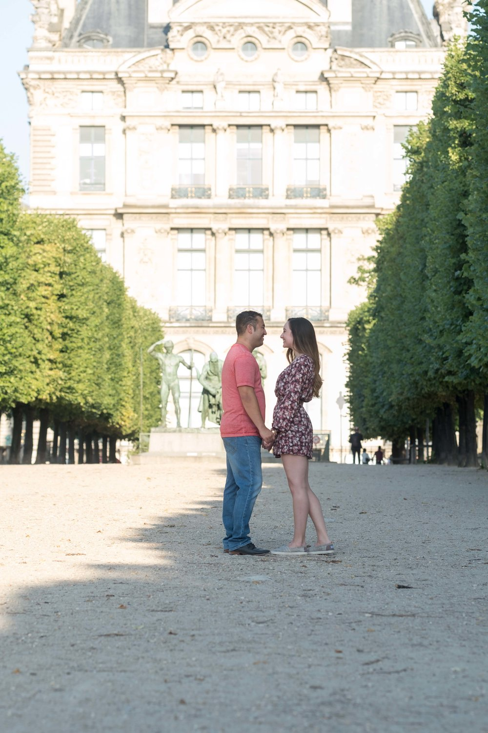 Couple in love outside Louvre Museum in Paris