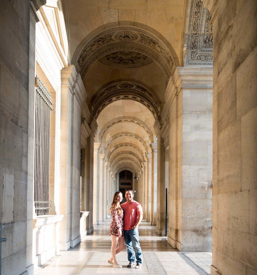 Couple in love posing at Louvre Museum in Paris