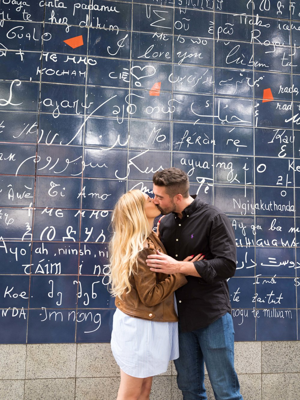 Couple kissing at the Wall of I Love Yous in Paris