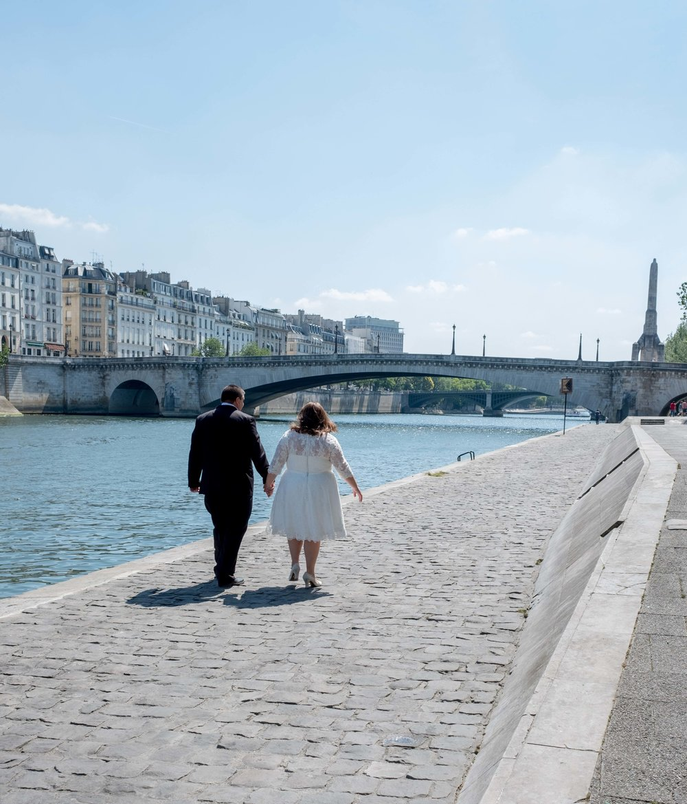 Newlyweds holding hands in Paris