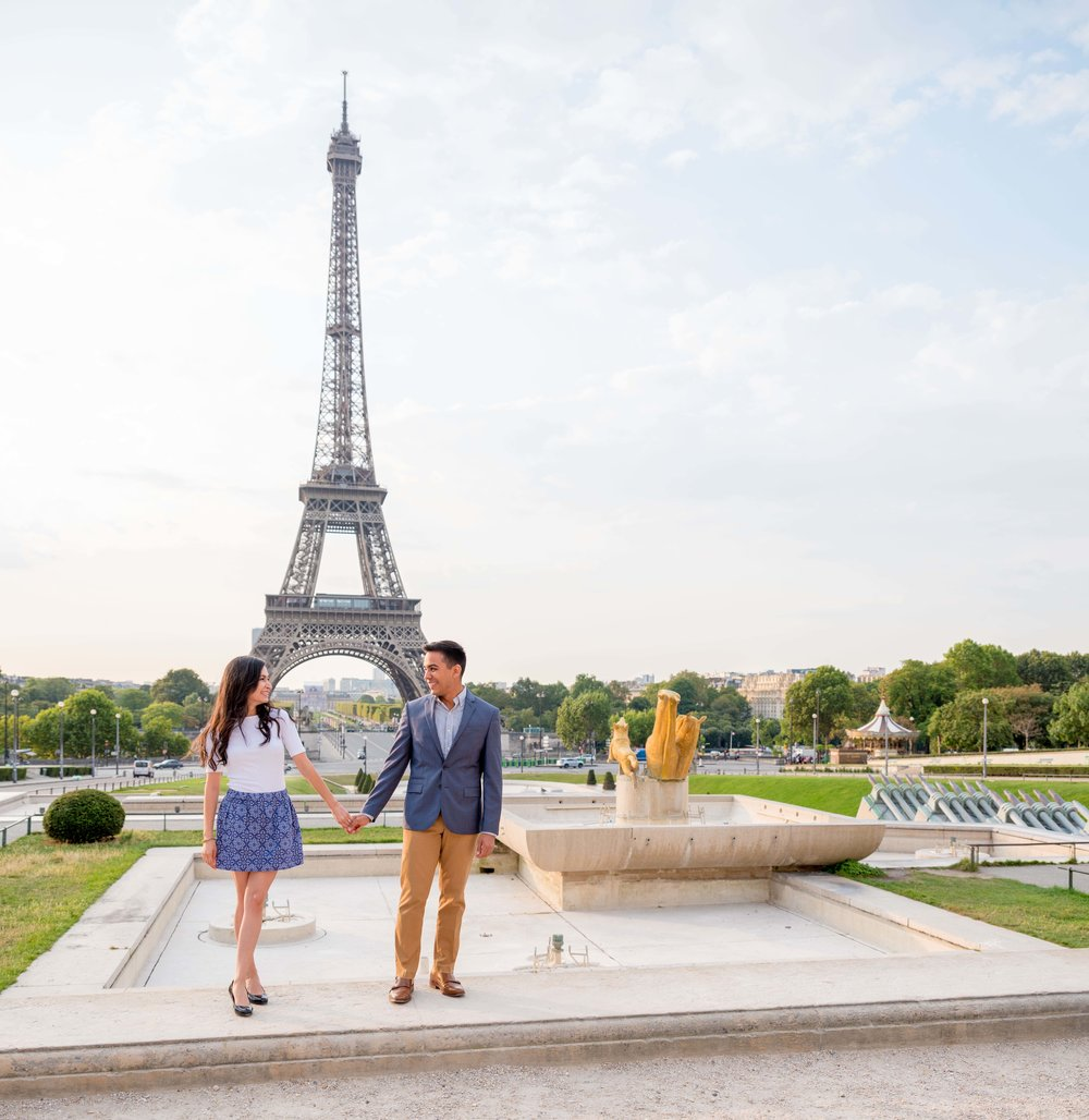 Couple standing in front of Eiffel Tower after surprise proposal