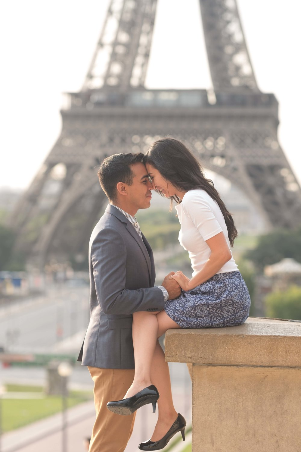 Couple laughing at Eiffel Tower in Paris