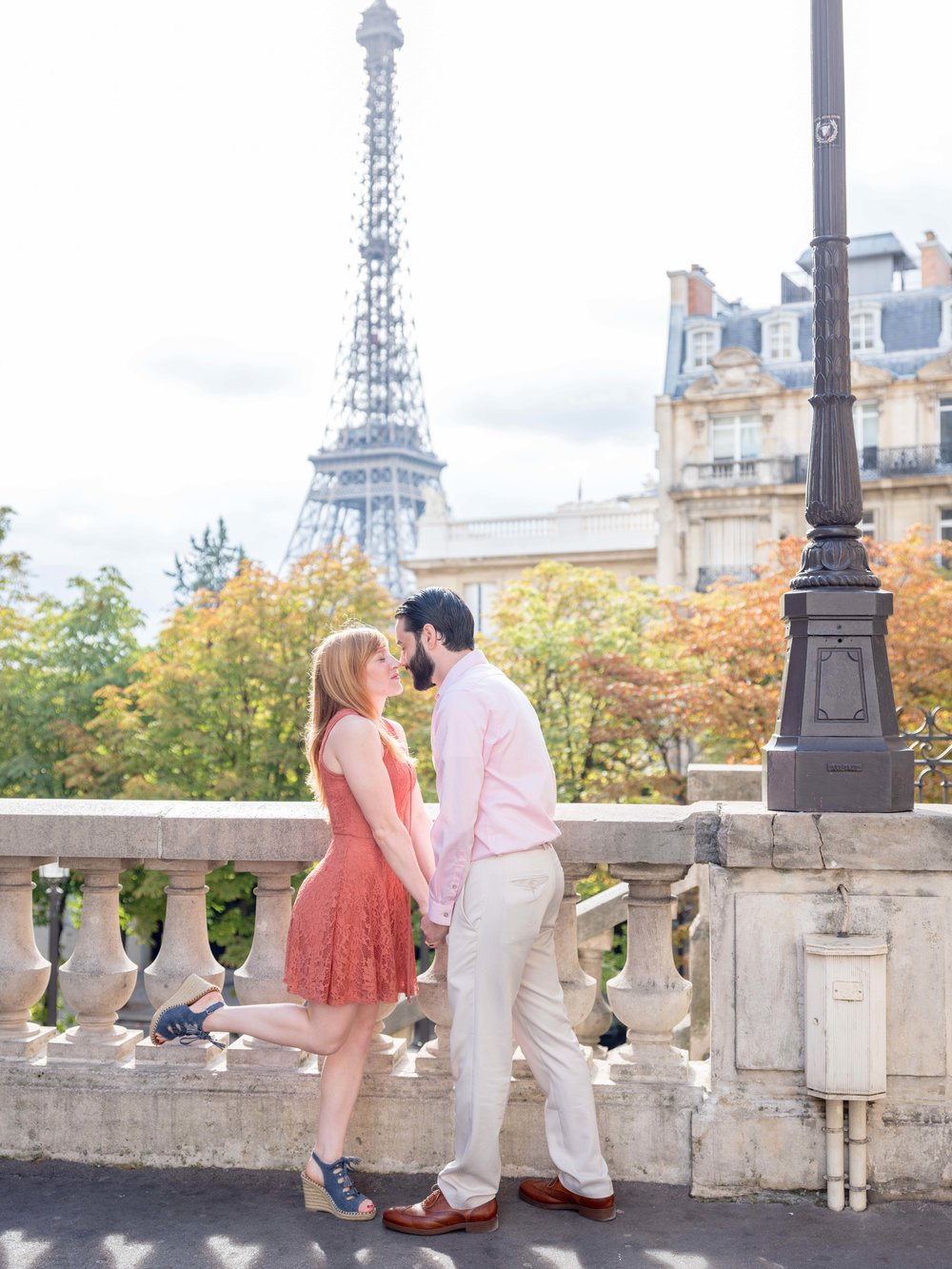 engaged couple in paris with view of eiffel tower