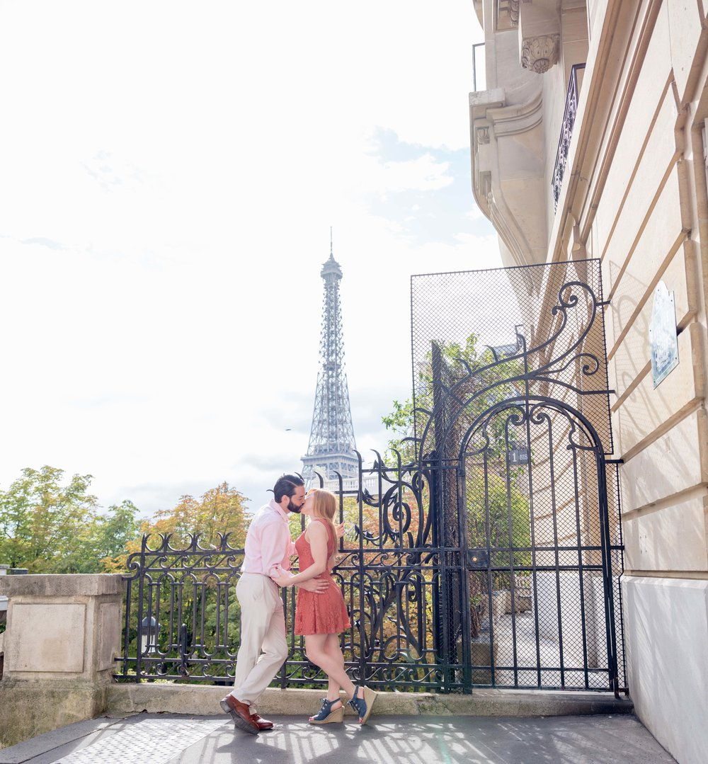 kissing couple in paris with eiffel tower in background