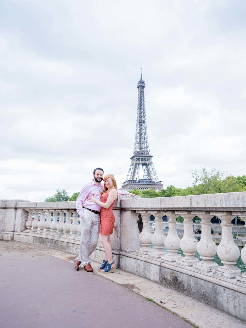 happy couple at the eiffel tower in paris