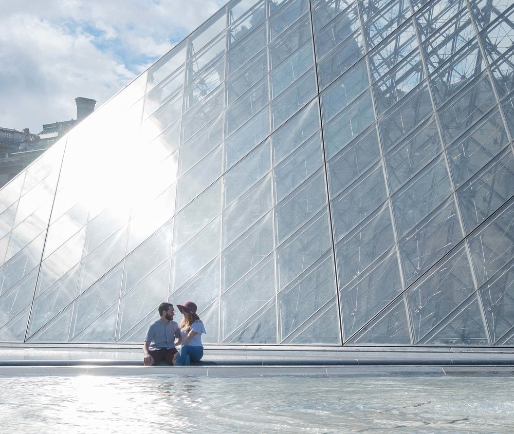 engaged couple at the louvre in paris france