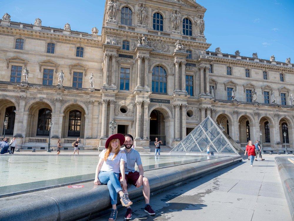 cute couple at louvre museum paris