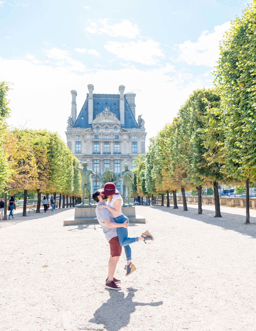 engaged couple in love at tuileries gardens in paris