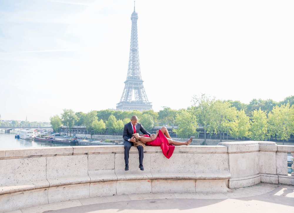 engaged couple at eiffel tower paris