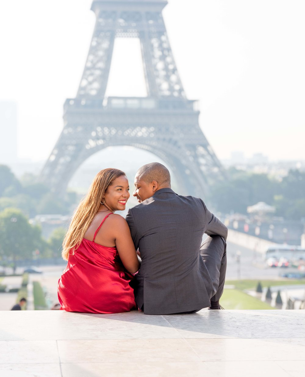 jache & davina - I'll always remember Davina as the beautiful lady in red for this elegant Paris photo shoot. We began at the Eiffel Tower and finished at the Louvre during our session, and it was as radiant as the love between this couple.See more images here