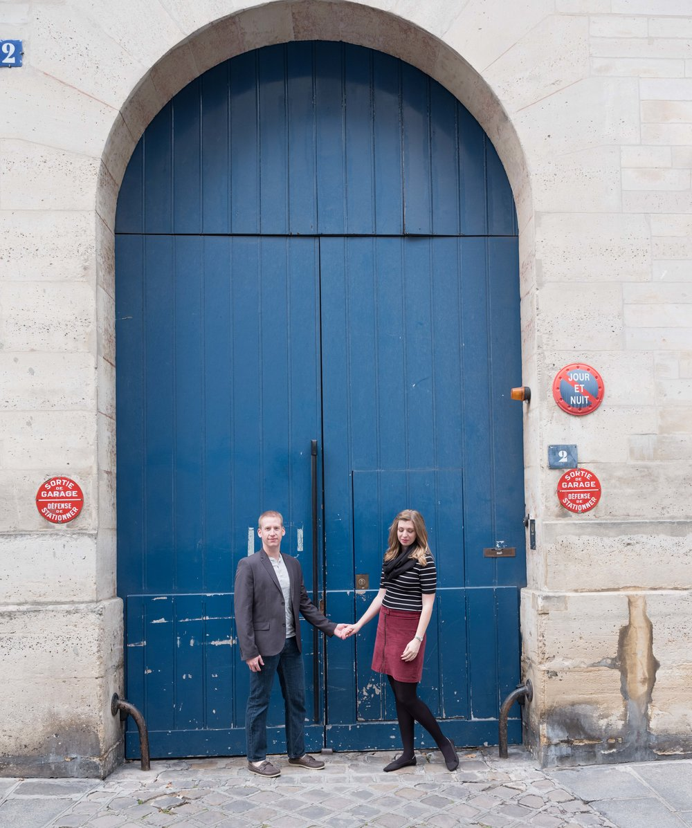 couple at blue door in paris