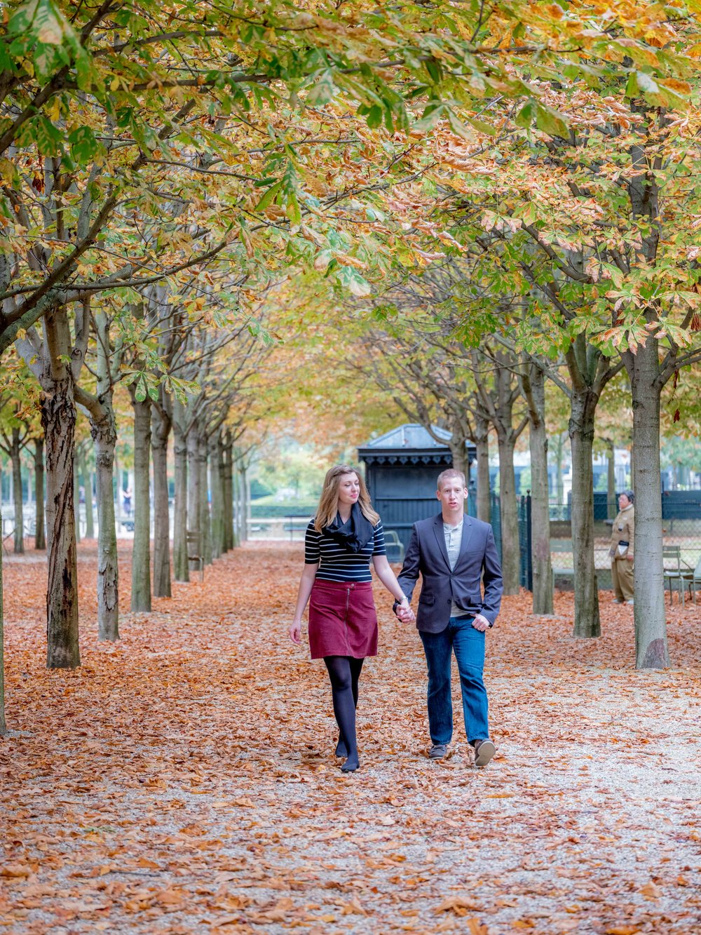 couple walking in autumn in paris