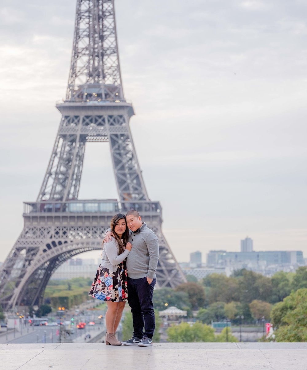 engaged couple at eiffel tower