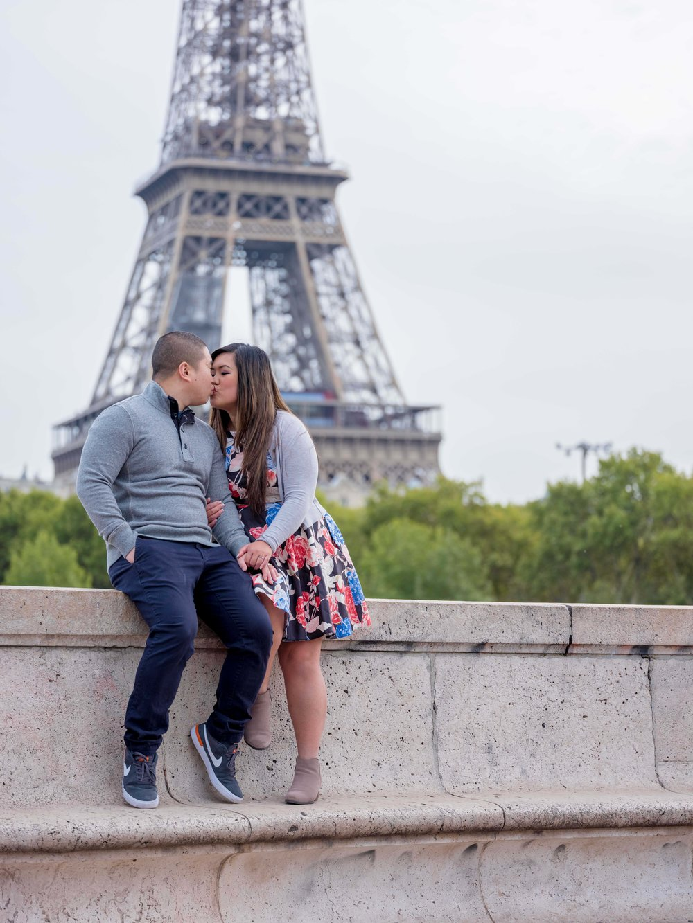 engaged couple in love at eiffel tower paris