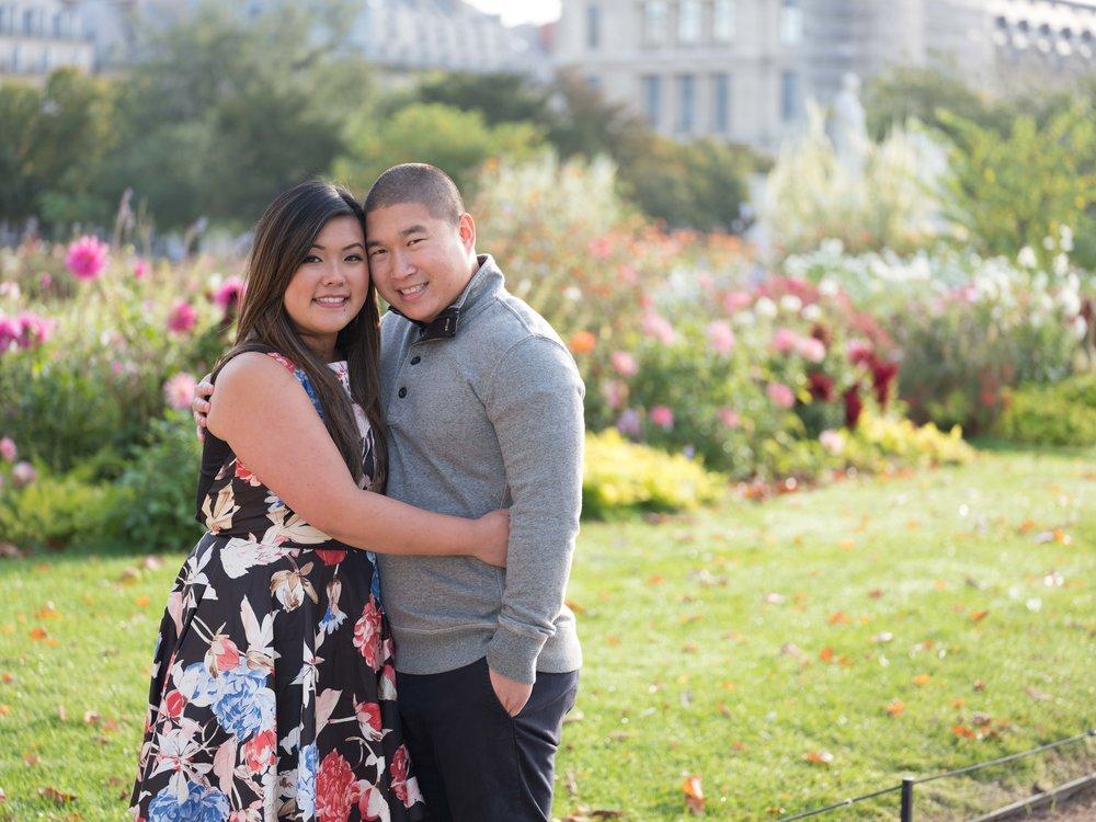 asian couple in garden in paris