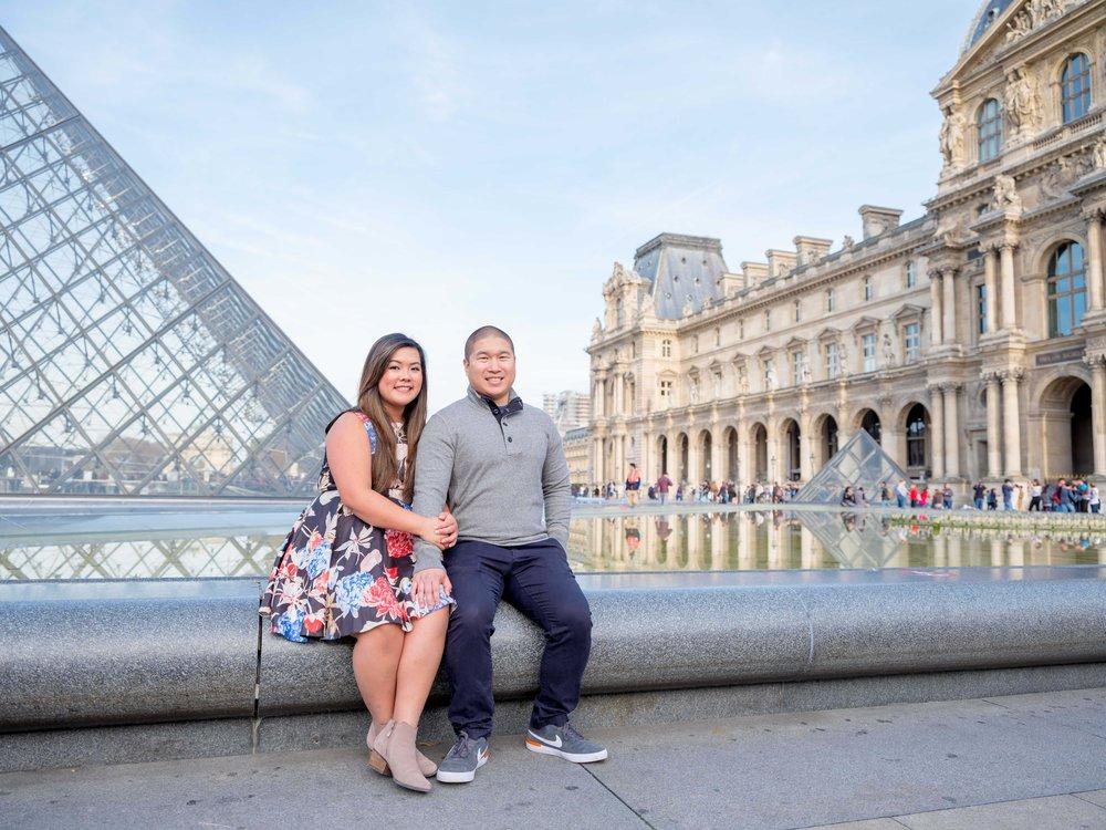 engaged asian couple at louvre museum paris