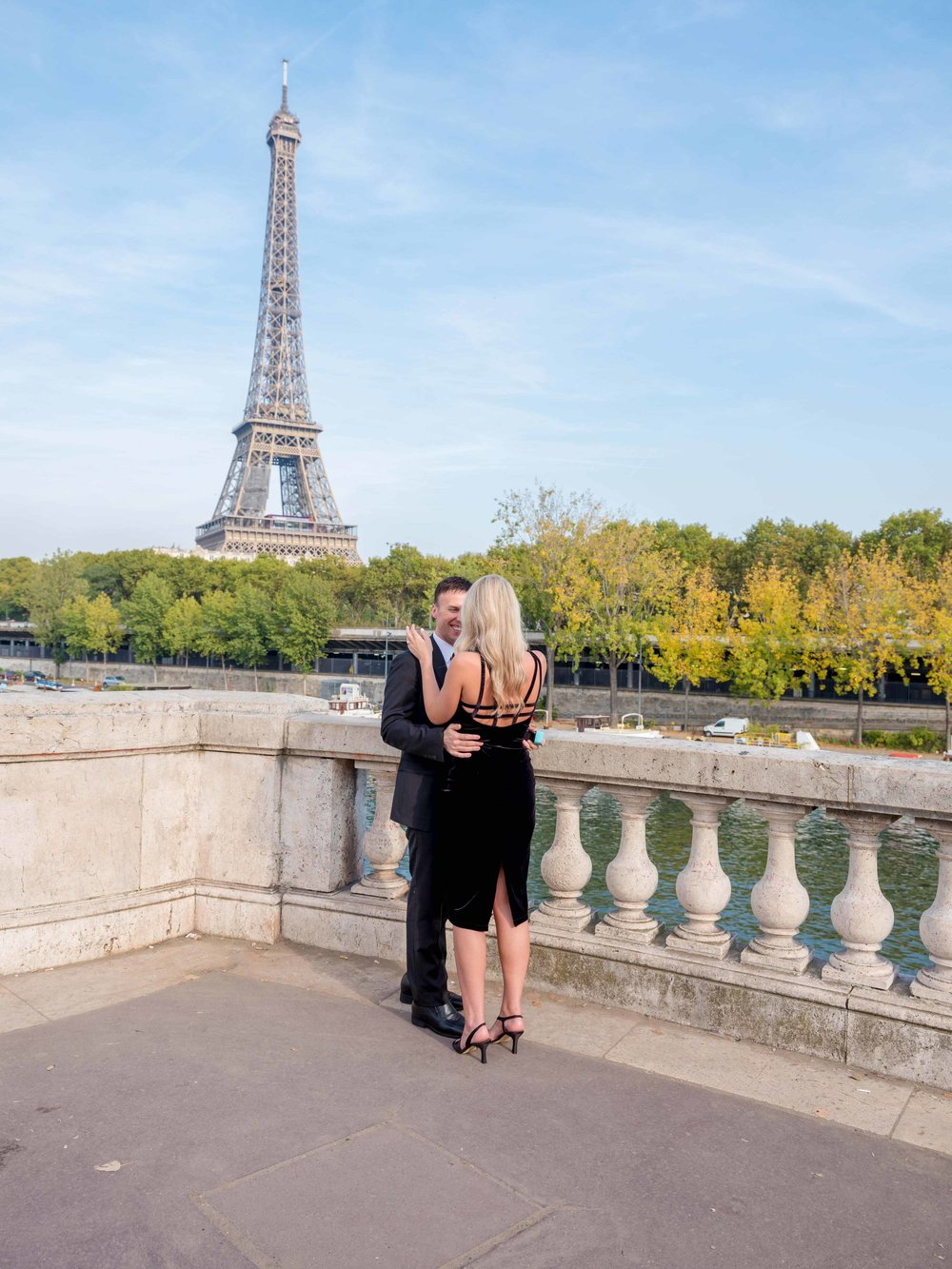 newly engaged couple at eiffel tower in paris
