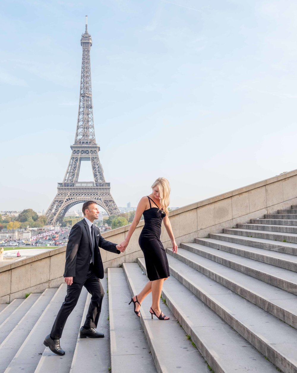 engaged couple at the eiffel tower paris