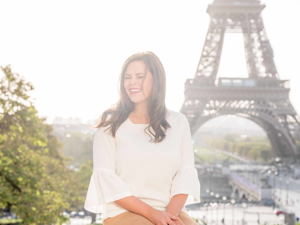 elegant woman posing at eiffel tower