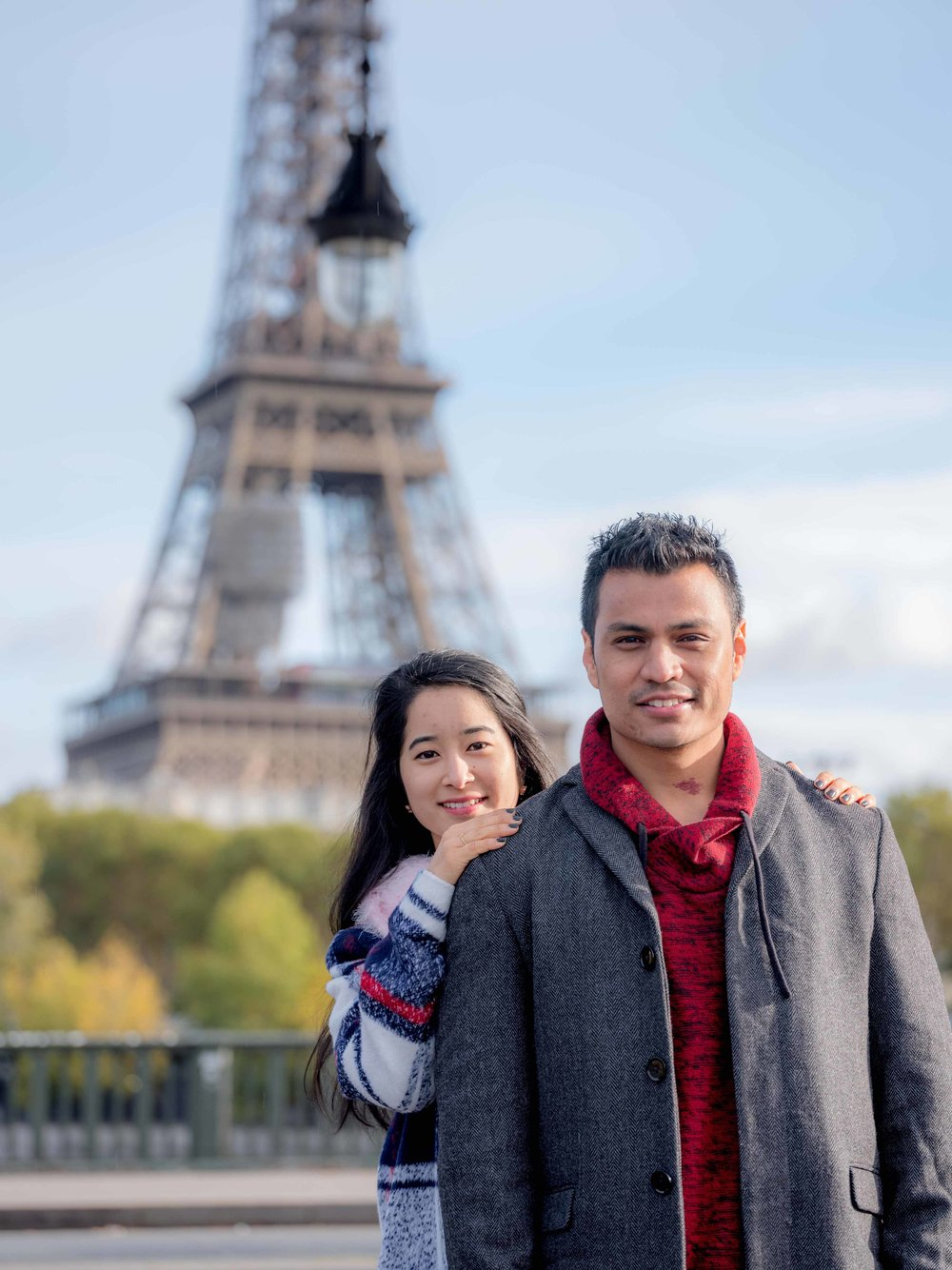 newly engaged couple at eiffel tower paris