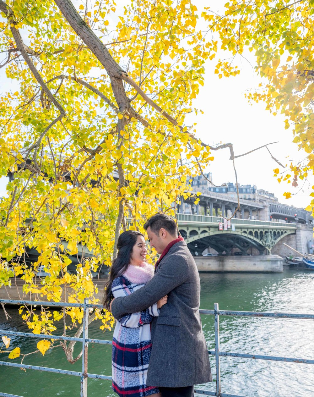 engaged couple in paris in autumn