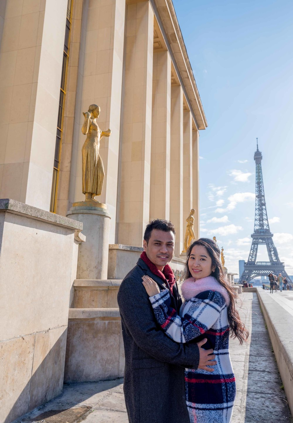 young couple engaged at eiffel tower paris